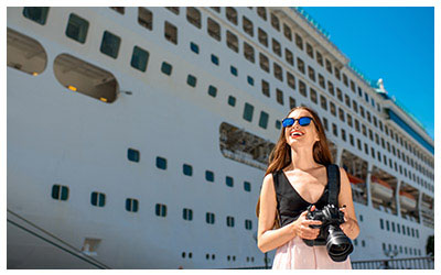 Image of a tourist in front of a cruise ship.