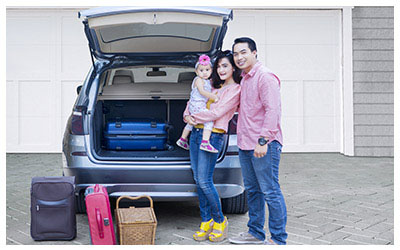 Image of a family going on vacation with their rental car.